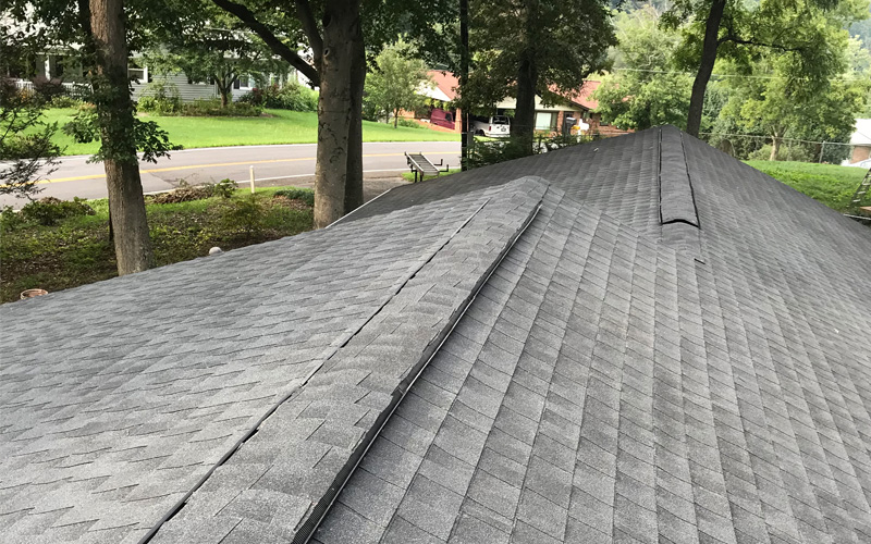 Photo of newly installed asphalt shingle roofing system
